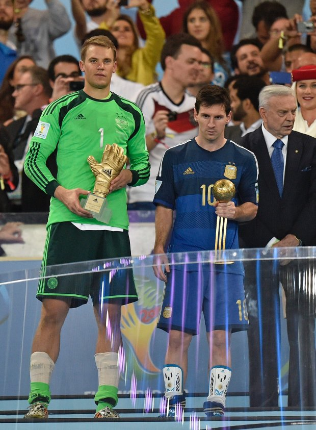 Germany's goalkeeper Manuel Neuer winner of the golden glove award for best goalkeeper stands alongside golden ball winner Argentina's Lionel Messi after the World Cup final soccer match between Germany and Argentina at the Maracana Stadium in Rio de Janeiro, Brazil, Sunday, July 13, 2014. Germany won the match 1-0. (AP Photo/Martin Meissner)