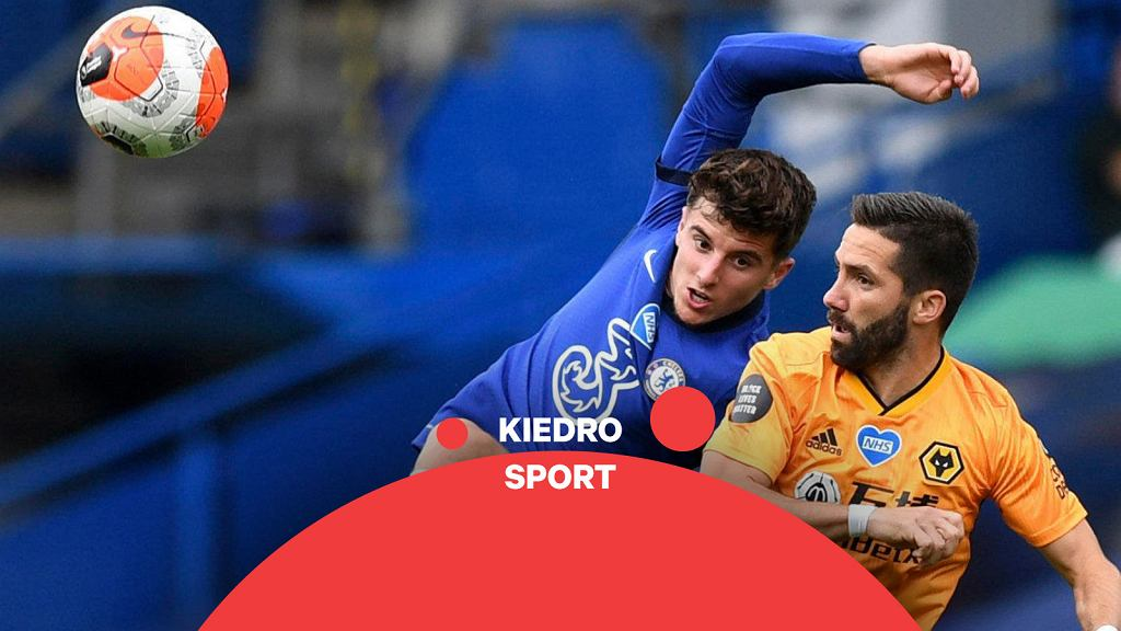 Wolverhampton Wanderers' Joao Moutinho, right, challenges Chelsea's Mason Mount during the English Premier League soccer match between Chelsea and Wolverhampton Wanderers at Stamford Bridge, in London, Sunday July 26, 2020.