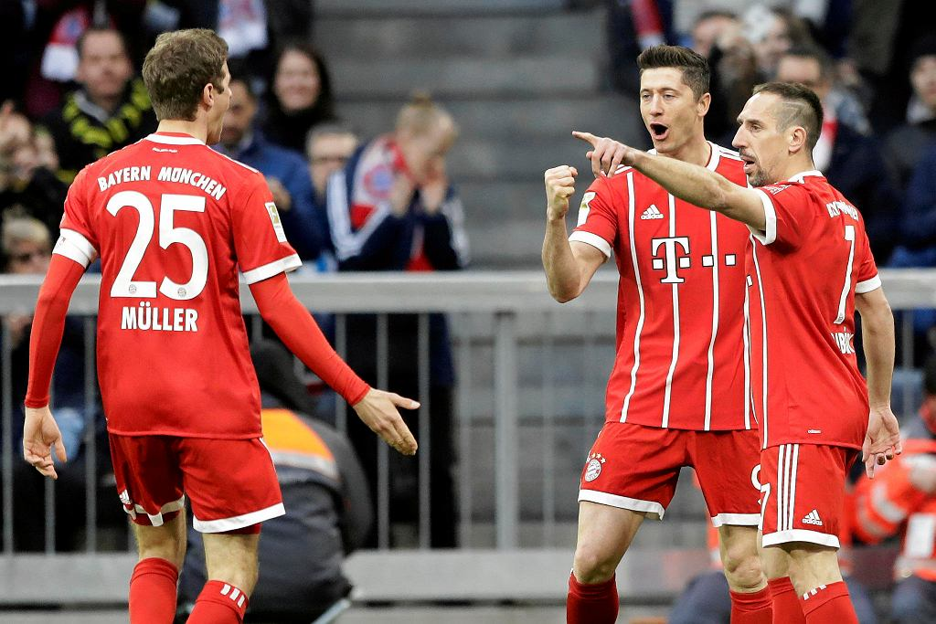 Bayern's Robert Lewandowski, center, Thomas Mueller, left, and Franck Ribery celebrate after Lewandowski scored