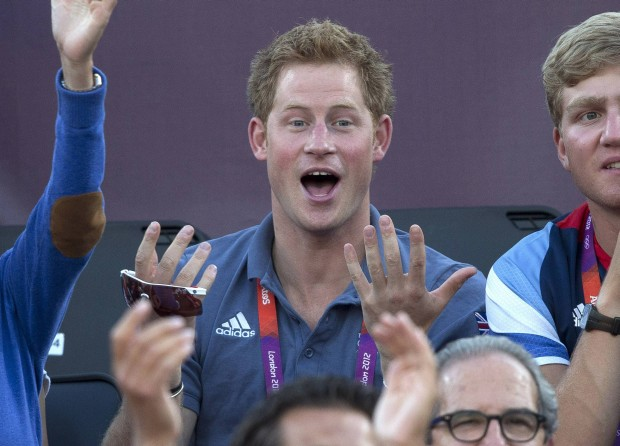 Britain's Prince Harry gestures as he watches the women's beach volleyball bronze medal match between Brazil and China at Horse Guards Parade during the London 2012 Olympic Games August 8, 2012. REUTERS/Neil Hall (BRITAIN - Tags: ENTERTAINMENT SPORT VOLLEYBALL OLYMPICS ROYALS)