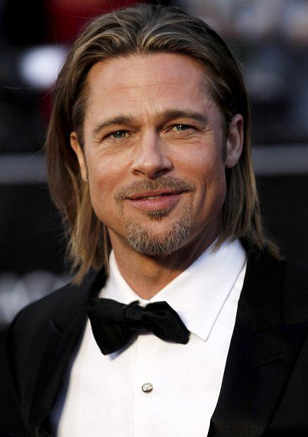 Actor Brad Pitt arrives before the 84th Academy Awards on Sunday, Feb. 26, 2012, in the Hollywood section of Los Angeles. (AP Photo/Matt Sayles)