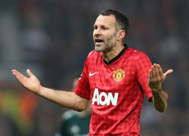 Manchester United's Ryan Giggs reacts after his teammate Nani was shown a red card during the Champions League round of 16 soccer match against Real Madrid at Old Trafford Stadium, Manchester, England, Tuesday, March 5, 2013. (AP Photo/Jon Super)