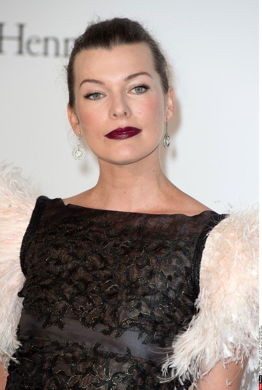 Mila Jovovich at AMFAR 21 th Cinema Against AIDS during the 67th Annual Cannes Film Festival at Hotel Du Cap  Antibes, FRANCE 22/05/2014 /NIVIERE_0042.55