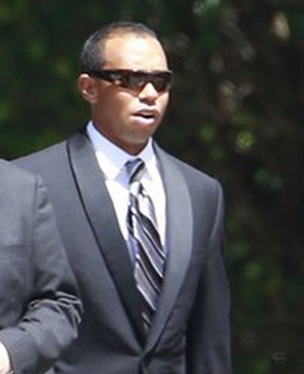 EXCLUSIVE: Tiger Woods was spotted arriving at his close friend and golfing buddy Michael Jordan's wedding in Florida. The golfing ace wore a sharp black suit and striped tie as he pulled up with security guards to the exclusive nuptials at Bethesda-By-The-Sea Church in Palm Beach on April 17, 2013. NBA legend Jordan, 50, was marrying his fiancee Yvette Prieto. Most guests entered the church through the front door but Woods used a side door in an effort to avoid awaiting press.     Pictured: Tiger Woods
