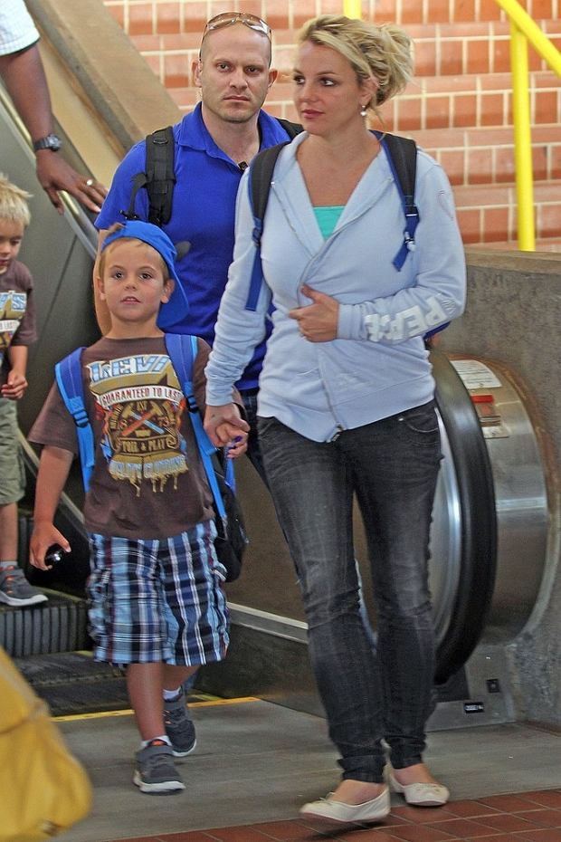 Britney Spears arrives in Maui with Jason Trawick and her sons. The pop star is in Hawaii for the fourth of July celebrations, and looked relaxed as she touched down in Maui.  Pictured: Britney Spears and Sean Federline