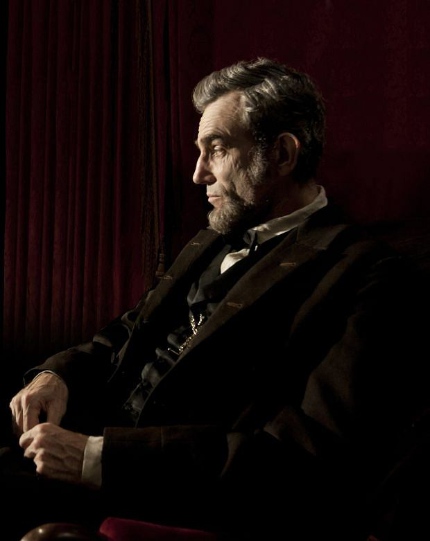 "FILE - This publicity film image released by DreamWorks and Twentieth Century Fox shows Daniel Day-Lewis portraying Abraham Lincoln in the film ""Lincoln.""  From the campaign of ?Lincoln,? the Steven Spielberg-directed film backed by The Walt Disney Co., critics say they've received no less than four coffee table books, an intricately framed DVD for review purposes and even a hand-signed letter from Spielberg himself, thanking them for recognizing the film with so many nominations. (AP Photo/DreamWorks, Twentieth Century Fox, David James, file)"