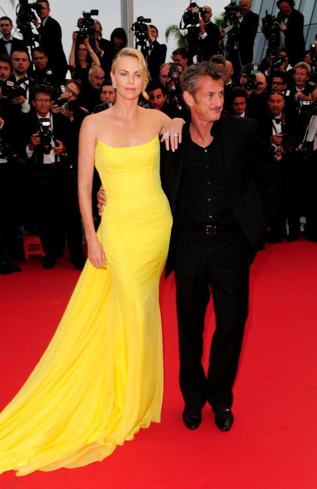CANNES, FRANCE - MAY 14: Sean Penn and Charlize Theron at the 'Mad Max: Fury Road' premiere during the 68th annual Cannes Film Festival on May 14, 2015 in Cannes, France.  PHOTOGRAPH BY Peter / Barcroft Media  UK Office, London. T +44 845 370 2233 W www.barcroftmedia.com  USA Office, New York City. T +1 212 796 2458 W www.barcroftusa.com  Indian Office, Delhi. T +91 11 4053 2429 W www.barcroftindia.com