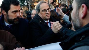 Premier rządu Katalonii Quim Torra (z prawej) i przewodniczący regionalnego parlamentu Roger Torrent przybywają do siedziby hiszpańskiego sądu najwyższego, Madryt, 12 lutego 2019 r.