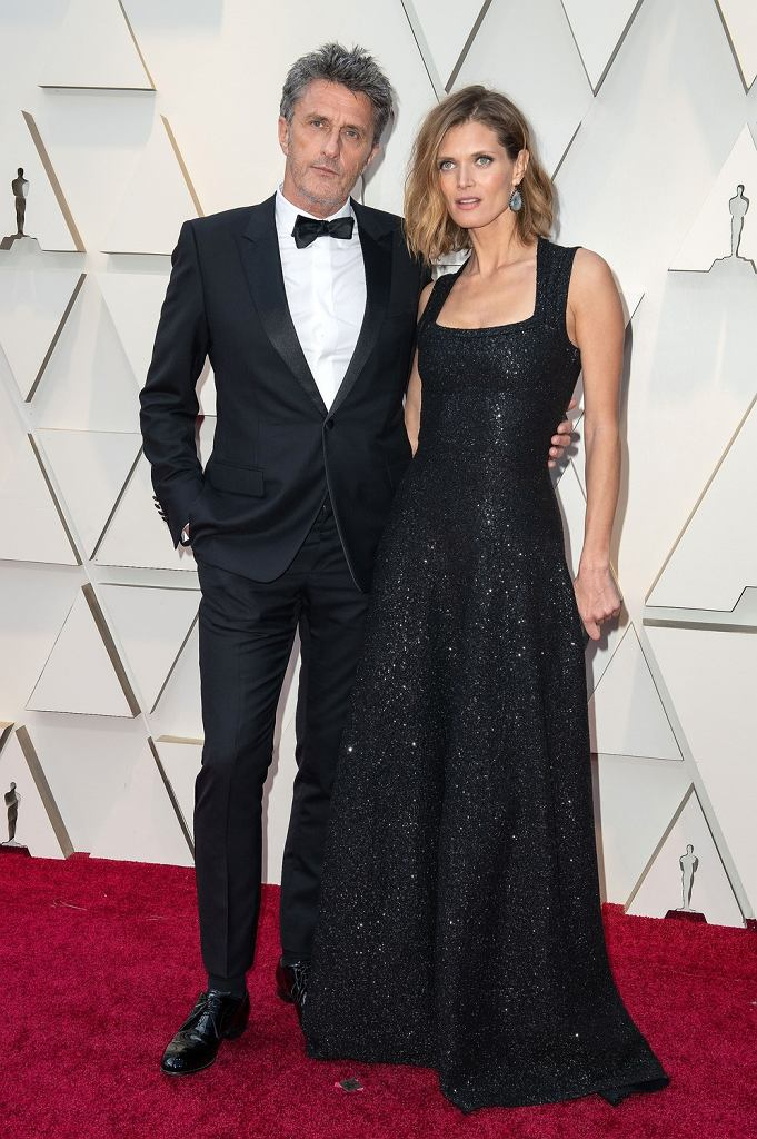Oscary 2019, Paweł Pawlikowski w garniturze Dior i Małgosia Bela w kreacji Azzedine Alaia