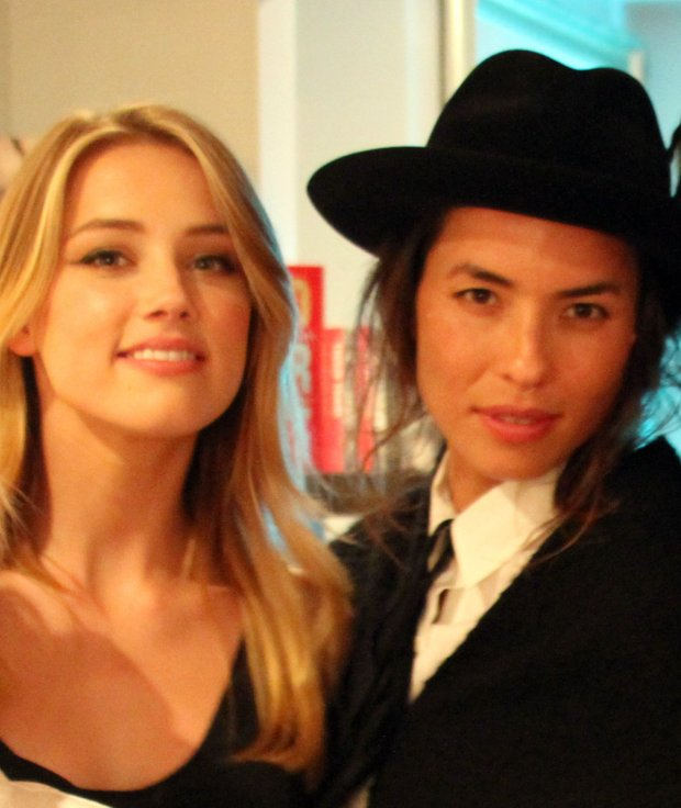 EXCLUSIVE: File Photos- Amber Heard seen with  Tasya Van Ree at the the Erotic City Group Show in Beverly Hills, CA, USA on December 15, 2010. TMZ.com has reported that Amber Heard was arrested for Domestic violence back in 2009 against then girlfriend Tasya Van Ree pictured here. The alleged incident occurred at the Seattle-Tacoma International Airport, where Amber allegedly grabbed and struck Tasya in her arm, which upset Tasya and triggered the arrest.  Amber was arrested and booked for misdemeanor domestic violence. Her mug shot was taken and she appeared in court the following day. Amber Heard and Johnny Depp are now also currently involved in an ongoing news story dealing also with alleged Domestic Violence.  Pictured: Amber Heard and Tasya Van Ree
