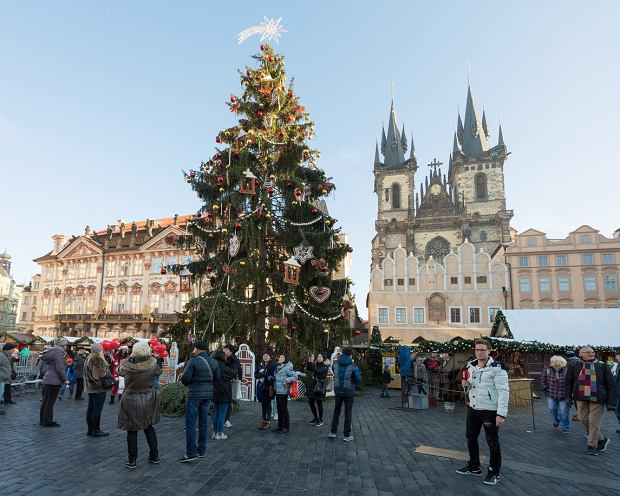 Prague, Czech Republic - December 3, 2016: Peoples on the famous advent Christmas market at Old Town Square with christmas tree in Prague. It is very popular destination with tourists visiting Prague. December 3, 2016 Prague, Czech Republic.