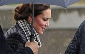 96416, **EXCLUSIVE** LONDON, UNITED KINGDOM - Tuesday May 14, 2013. Kate Middleton, due to give birth around July, braves the rain and carries her own bags after shopping for her and Prince Williams Kensington home in London. Middleton, who was wearing no socks with her casual outfit, was kept dry by a few umbrellas held by her security team after shopping at Crucial Trading. **UK PAPERS OUT** Photograph: ? PacificCoastNews.com **FEE MUST BE AGREED PRIOR TO USAGE** **E-TABLET/IPAD & MOBILE PHONE APP PUBLISHING REQUIRES ADDITIONAL FEES** LOS ANGELES OFFICE: +1 310 822 0419 LONDON OFFICE: +44 20 8090 4079