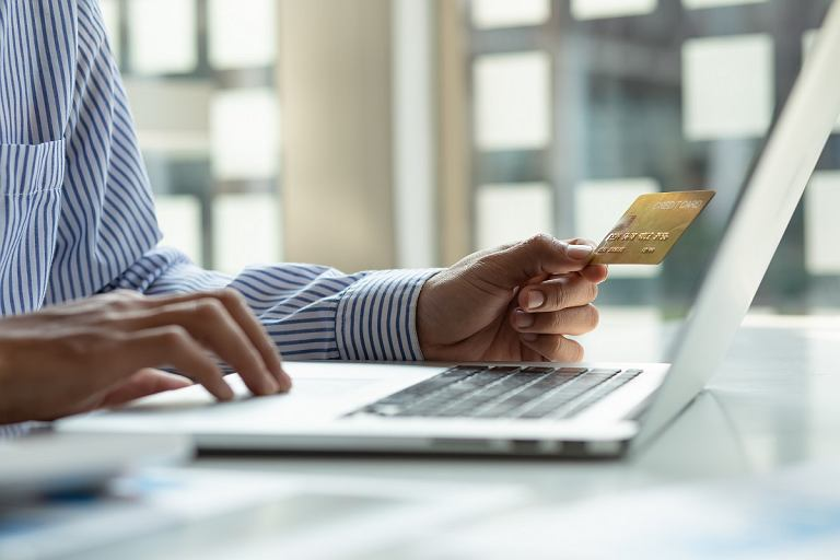 IOnline,Payment,businessman,Hands,Holding,Credit,Card,And,Using,Laptop,For