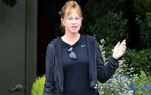 EXCLUSIVE: Melanie Griffith shops for flowers at Rolling Greens Nursery in Los Angeles, California. The actress looked like she had just come from the gym in her work out gear as she strolled around the high end garden store. She looked slim in leggings and a Nike top. Melanie was seen perusing the plants and at one point received help from a shop assistant who helped her pick out some purchases and then loaded them into the trunk of the car. Melanie left with three large bags of flowers and a small bouquet.   Pictured: Melanie Griffith