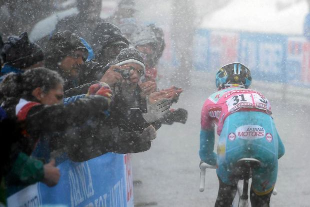 Italy's Vincenzo Nibali pedals on his way to win the 20th stage of the Giro d'Italia, Tour of Italy cycling race, from Silandro to Tre Cime di Lavaredo, Saturday May 25, 2013. Vincenzo Nibali virtually wrapped up the Giro d'Italia title with a dominating solo performance to win the penultimate stage Saturday, leaving behind all of his rivals under a blizzard of snow on the race's final climb. Nibali attacked with 3 kilometers (under 2 miles) to go on the steep ascent to Tre Cime di Lavaredo, the three-week race's highest point at an altitude of 2,304 meters (7,550 feet). On the final stages of the climb, the road was surrounded by huge banks of snow. (AP Photo/Fabio Ferrari)