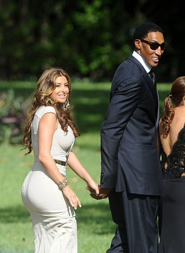 A sharply-dressed Michael Jordan was spotted making a swift exit from his high-security Florida wedding in a white Rolls Royce. The NBA legend chose not to show off his bride Yvette Prieto to awaiting fans and press, instead enlisting dozens of security guards to conceal the happy couple with white umbrellas. As a Jordan-lookalike rolled up outside the church in a black SUV and waved to screaming fans, the basketball superstar himself was whisked away from the the chapel after the April 27 nuptials. VIP guests included his ex-Chicago Bulls team mate Scottie Pippen and his wife Larsa, former pro-basketballer Patrick Ewing and golfing ace Tiger Woods had been spotted at the exclusive event, which took place at Bethesda-By-The-Sea Church, in Palm Beach, as well as Jordan's mother Dolores Jordan. The 2000-plus guests later celebrated at a lavish after party inside the Bear's Club gated community in nearby Jupiter, where Jordan has a stunning mansion.  Pictured: Scottie Pippen and Larsa Pippen