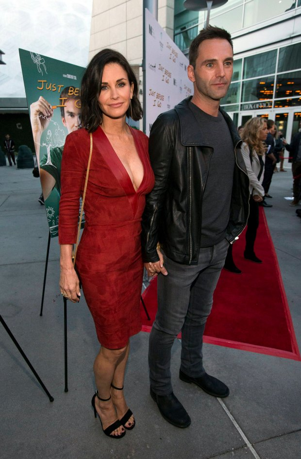 Director of the movie Courteney Cox and fiance Johnny McDaid pose at the premiere of