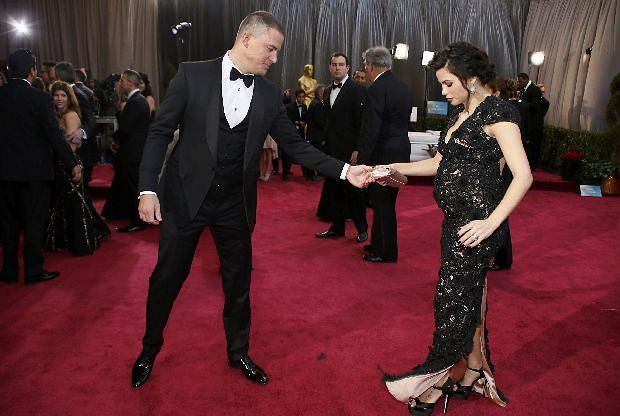 Actor Channing Tatum and his wife Jenna Dewan arrive at the 85th Academy Awards in Hollywood, California February 24, 2013.  REUTERS/Lucy Nicholson  (UNITED STATES TAGS:ENTERTAINMENT) (OSCARS-ARRIVALS)