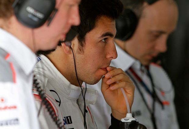 McLaren Mercedes driver Sergio Perez of Mexico, center, follows the cars on a screen during the third practice session of the Bahrain Formula One Grand Prix at the Bahrain International Circuit in Sakhir, Bahrain, Saturday, April 20, 2013. The Bahrain Formula One Grand Prix will take place on Sunday. (AP Photo/Kamran Jebreili)