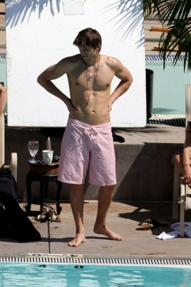 Ashton Kutcher filming a scene by a pool wearing just his trunks in Los Angeles. <P> <B>Ref: SPL23124  240308  </B><br> Picture by: Dean Chapple / Splash News<br> Pictured: Ashton Kutcher </P><P> <B>Splash News and Pictures</B><br> Los Angeles: 310-821-2666<br> New York: 212-619-2666<br> London: 870-934-2666<br> photodesk@splashnews.com<br> </P>