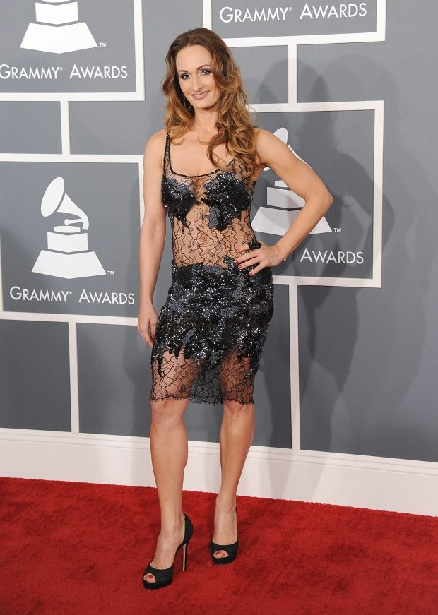 D'manti arrives at the 55th annual Grammy Awards on Sunday, Feb. 10, 2013, in Los Angeles.  (Photo by Jordan Strauss/Invision/AP)