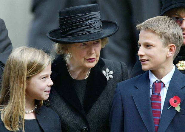 July 3, 2003, London, United Kingdom: July 3, 2003 - London, United Kingdom: Lady Thatcher with her grandchildren Michael and Amanda at a memorial service for her husband Dennis in London in 2003.  (Stephen Lock/POLARIS). Credit: Andrew Parsons / Polaris