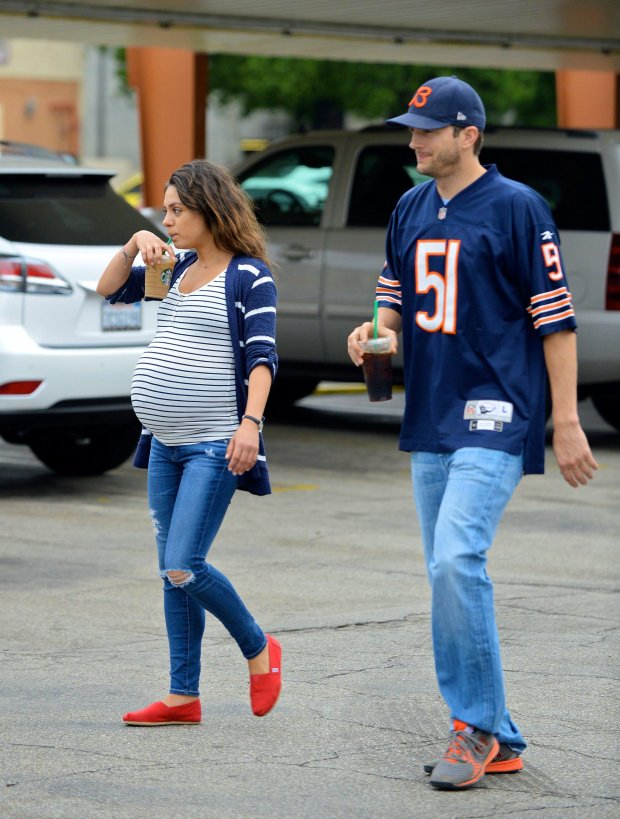 NNATIONAL PHOTO GROUP The very pregnant Mila and Ashton start their day off with Starbucks before taking their dogs to the park. Mila appears to be falling behind at the park but keeps hydrated with her coffee. Later the couple gets brunch at a cozy LA cafe nearby.Job: 092114J6EXCLUSIVE Sept. 21st 2014 Los Angeles, CANPG.com
