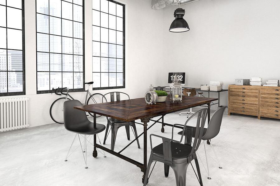 Minimalistyczny loft, w którym dominują biel, beton oraz meble ze stali i drewna.