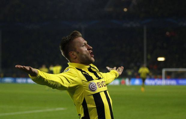Borussia Dortmund's Jakub Blaszczykowski celebrates a goal against Shakhtar Donetsk during the Champions League soccer match in Dortmund March 5, 2013. REUTERS/Ina Fassbender  (GERMANY - Tags: SPORT SOCCER)