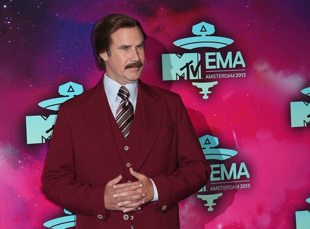 Actor Will Ferrell, dressed as the character Ron Burgundy, poses for photographers upon arrival at the 2013 MTV Europe Music Awards, in Amsterdam, Netherlands, Sunday, Nov. 10, 2013. (Photo by Joel Ryan/Invision/AP)