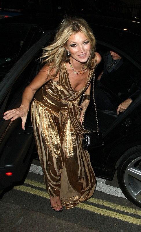 Kate Moss seen here at her after party to her book signing earlier on in the night. The after party took place at St James in London. Kate wore a stunning long gold gown, she stopped and posed for pictures and looked very happy as she entered the party. Some of Kate's celebrity friends were seen attending the party such as Florence Welch, Stella McCartney, Bob Geldof, Noel Gallagher, Cara Delevingne and Nick Grimshaw.  Pictured: Kate Moss