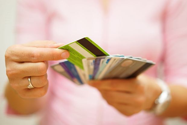 woman choose one credit card from many, concept of  credit card debt,