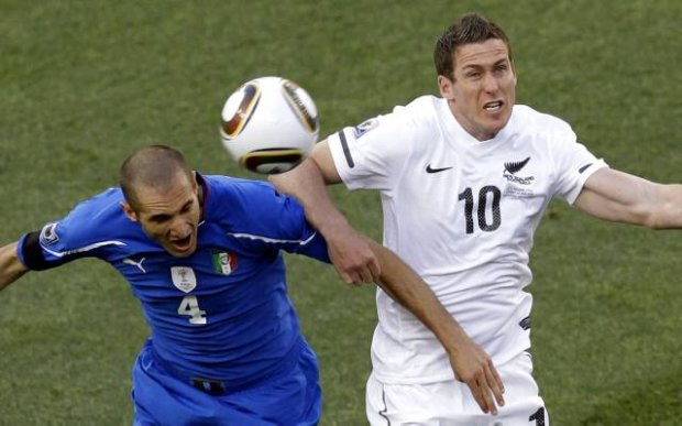 Italy's Giorgio Chiellini, left, and New Zealand's Chris Killen compete during the World Cup group F soccer match between Italy and New Zealand at Mbombela Stadium in Nelspruit, South Africa, Sunday, June 20, 2010.  (AP Photo/Michael Sohn)