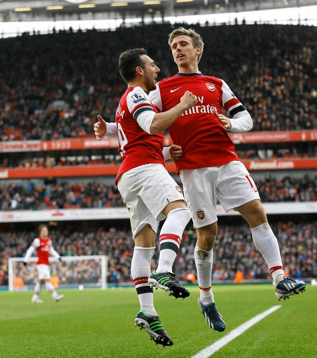 Arsenal's Santi Cazorla, left, celebrates scoring a goal with Nacho Monreal during the English Premier League soccer match between Arsenal and Reading at the Emirates Stadium in London, Saturday, March 30, 2013. (AP Photo/Kirsty Wigglesworth)  SLOWA KLUCZOWE: XPREMIERX