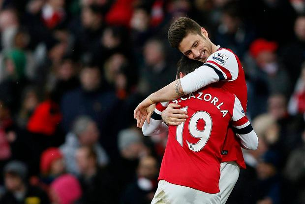 """Arsenal's Olivier Giroud (R) celebrates with team mate Santi Cazorla after scoring against Reading during their English Premier League soccer match at the Emirates Stadium in London March 30, 2013. REUTERS/Stefan Wermuth (BRITAIN - Tags: SPORT SOCCER) NO USE WITH UNAUTHORIZED AUDIO, VIDEO, DATA, FIXTURE LISTS, CLUB/LEAGUE LOGOS OR """"LIVE"""" SERVICES. ONLINE IN-MATCH USE LIMITED TO 45 IMAGES, NO VIDEO EMULATION. NO USE IN BETTING, GAMES OR SINGLE CLUB/LEAGUE/PLAYER PUBLICATIONS. FOR EDITORIAL USE ONLY. NOT FOR SALE FOR MARKETING OR ADVERTISING CAMPAIGNS SLOWA KLUCZOWE: :rel:d:bm:GF2E93U1BVI01"""