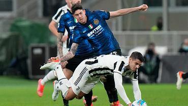 Inter Milan's Alessandro Bastoni and Juventus' Alvaro Morata challenge for the ball during a Serie A soccer match between Inter Milan and Juventus
