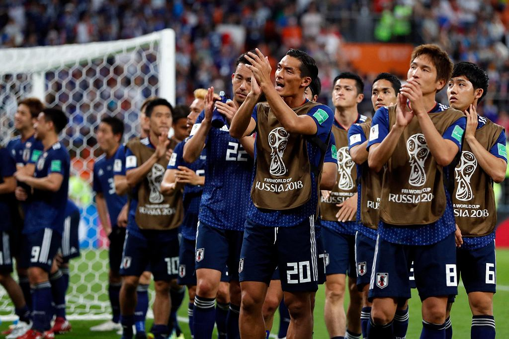 Japan players celebrate at the end of the group H match between Japan and Senegal at the 2018 soccer World Cup at the Yekaterinburg Arena in Yekaterinburg , Russia, Sunday, June 24, 2018. Japan and Senegal tied 2-2. (AP Photo/Natacha Pisarenko) SLOWA KLUCZOWE: WC2018SEN;WC2018JPN