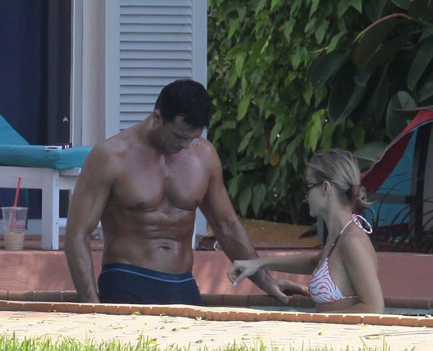'Real Housewive's Joanna Krupa and husband Romain Zago seen by the pool in Miami Beach.  Pictured: Joanna Krupa and Romain Zago