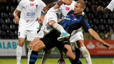 Igor Lewczuk (niebiesko-czarny strój)