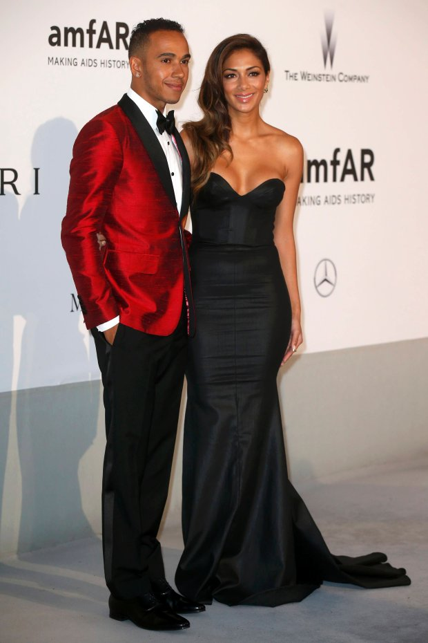 Mercedes Formula One driver Lewis Hamilton (L) and singer Nicole Scherzinger arrive for amfAR's Cinema Against AIDS 2014 event in Antibes during the 67th Cannes Film Festival May 22, 2014.     REUTERS/Benoit Tessier (FRANCE  - Tags: ENTERTAINMENT SPORT MOTORSPORT)