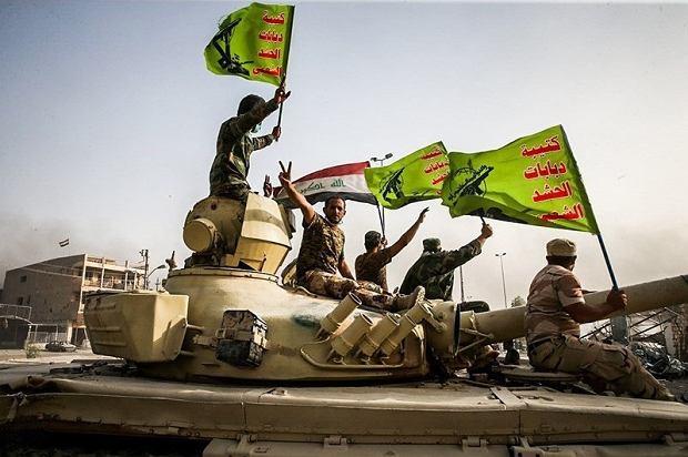 Członkowie milicji PMU podczas walk z tzw. Państwem Islamskim. Formacja składa się głównie z szyitów i jest pod pośrednią kontrolą szyickiego Iranu a nie głównie sunnickich władz irackich