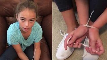 Dziewczynka uwalnia się z zaimprowizowanych kajdanek