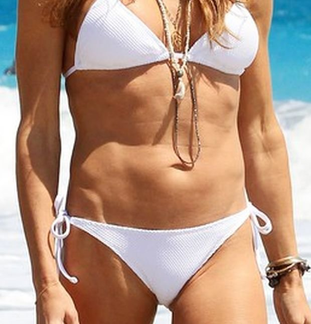 Kelly Bensimon shows off her bikini body in a white Letarte two piece in West Palm Beach.  The former New York housewife took to the beach before her book signing at the Letarte Swimwear shop on Worth Avenue wearing the same bikini that Kate Upton wore on the cover of the Sports Illustrated Swimsuit edition.   Pictured: Kelly Bensimon