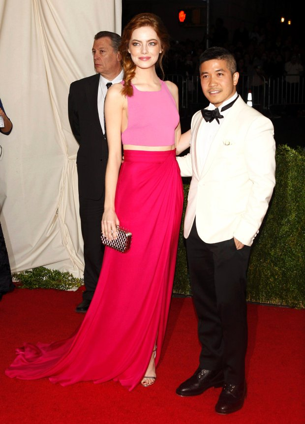 """Actress Emma Stone and designer Thakoon Panichgul arrive at the Metropolitan Museum of Art Costume Institute Gala Benefit celebrating the opening of """"Charles James: Beyond Fashion"""" in Upper Manhattan, New York May 5, 2014. REUTERS/Carlo Allegri   (UNITED STATES - Tags: ENTERTAINMENT FASHION)"""