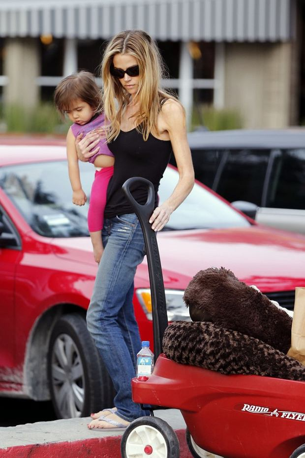 Denise Richards shops at a local market in BelAir, CA with her daughters Eloise, Sam and Lola. Richards was also towing a buggy loaded up with goods including what looks like a new dogs bed.  Pictured: Eloise,Denise Richards