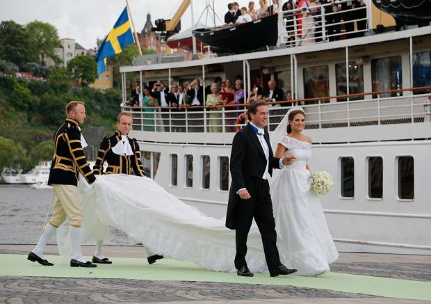 Sweden's Princess Madeleine and and her husband Christopher O'Neill, arrive Saturday June 8, 2013 at the boat that will take them to Drottningholm Palace, Sweden, where the wedding dinner is to be held after their wedding in Stockholm. (AP Photo/Adam Ihse)   SWEDEN OUT