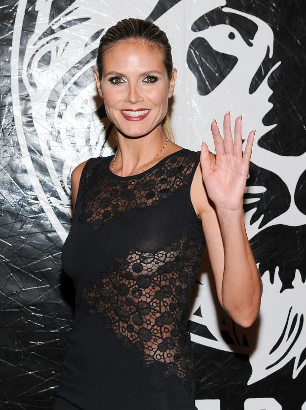 Television personality Heidi Klum attends the Versus Versace and Capsule Collection fashion show at the 69th Regiment Armory on Wednesday, May 15, 2013 in New York. (Photo by Evan Agostini/Invision/AP)