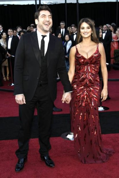 Actor Javier Bardem, left, and Penelope Cruz arrive before the 83rd Academy Awards on Sunday, Feb. 27, 2011, in the Hollywood section of Los Angeles. (AP Photo/Matt Sayles)
