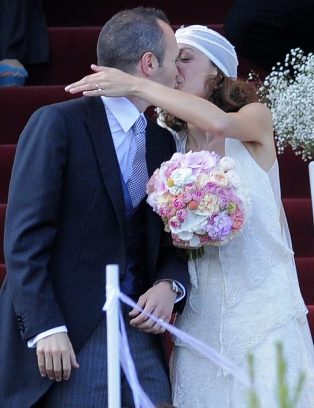 FC Barcelona's Andres Iniesta kisses his wife Anna Ortiz during his wedding at the castle of Tamarit in Tarragona, Spain, Sunday, July 8, 2012. (AP Photo/Manu Fernandez)