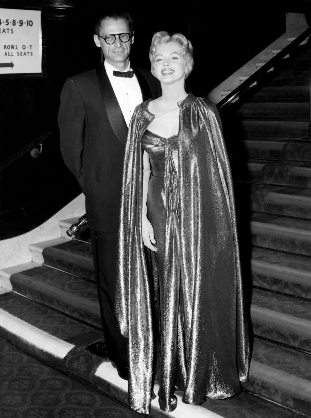 """In this late October 1956 publicity photo provided by Running Press, Marilyn Monroe, right, with husband Arthur Miller, is shown in the final weeks of filming """"The Prince and the Showgirl."""" This goddess-like ensemble is in a burnished gold lam?. (AP Photo/Courtesy Running Press)"""